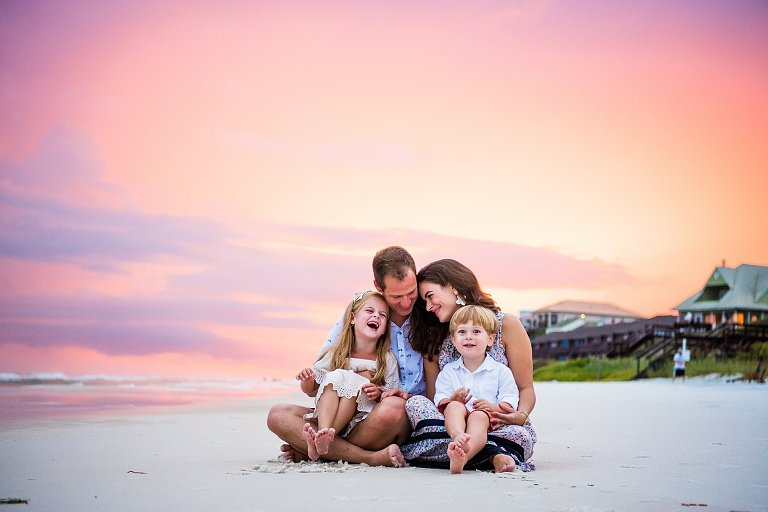 Pink & Purple Skies behind a family of 4 in a Rosemary Beach Session by Rosemary Beach Photographer Two Lights Photography